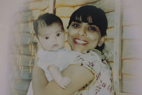 Daksha Emson holds her baby daughter Freya.